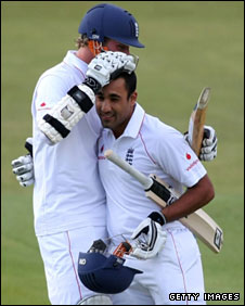 Ravi Bopara (right) is hugged by batting partner Stuart Broad after reaching his century