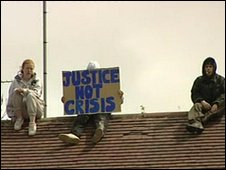 Justice Not Crisis campaigners on a Pershore Road rooftop