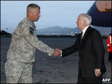 Robert Gates (right) is greeted by US Army General David McKiernan in Kabul, 6 May