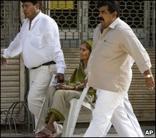 An elderly voter is carried while voting in Delhi on 7 May 2009