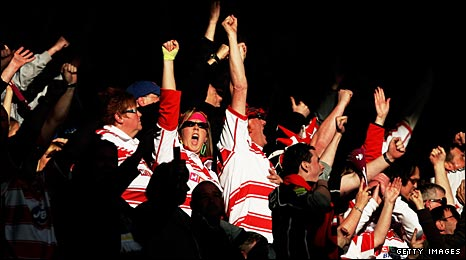 Wigan fans celebrate their team's win over St Helens