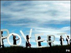 Poverty letters on hillside