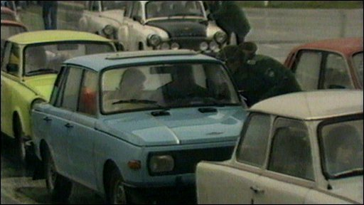 Cars queueing to leave East Germany