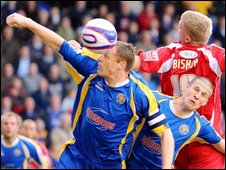 Shrewsbury's Graham Coughlan, Paul Murry and Bury's Andy Bishop