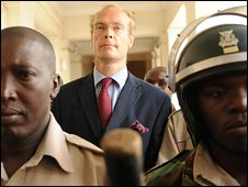 Thomas Cholmondeley (C), son of the fifth Baron Delamere and great-grandson of Kenya's most prominent early settler, arrives in Nairobi High Court on Thursday