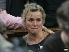 The partner of Thomas Cholmondeley, Sally Dudmesh, is comforted by friends after a judge found Cholmondeley guilty of manslaughter, in Nairobi's high court on Thursday