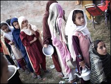 Young girls, fleeing military operations in Pakistan's Swat Valley, queue for rations in a relief camp on Friday in Mardan