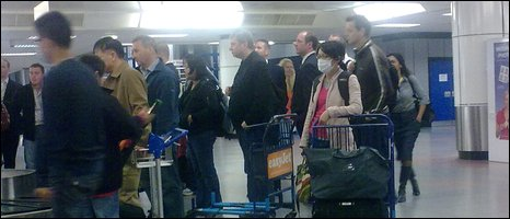 Woman wearing mask at Belfast International Airport