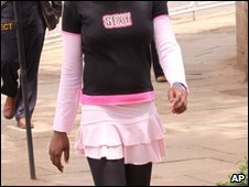 "A young Kenyan woman wears a top marked ""Sexy"" through Nairobi, 30 April"