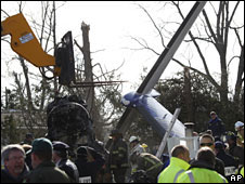 Workers and investigators clear debris from the scene of the plane crash of Continental Connection Flight 3407 on 16 February, 2009 in Clarence, New York