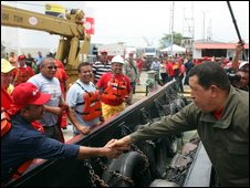 Venezuelan President Hugo Chavez, right, shakes hand with an oil worker in Lagunillas, Lake Maracaibo, on 8 May 2009.