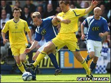 Neil Harris and Richard Naylor battle for the ball