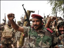General Hassan Al Gadam Al Jinedi of the Chad army raises his fist in victory on 8 May in the area of Am Dam