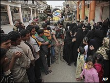Baghdad residents queue for food rations