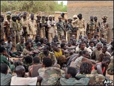 Chad soldiers guard rebel prisoners near Am Dam, 8 May