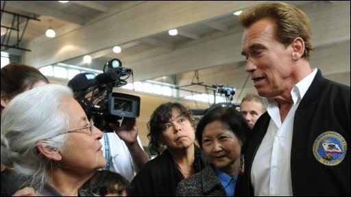 California Governor Arnold Schwarzenegger visits some of the fire evacuees