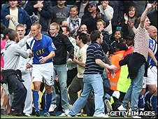 Millwall fans took to the pitch after Neil Harris scored against Leeds