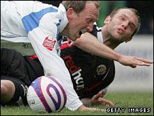 Neil Ashton fouls Andy Morrell