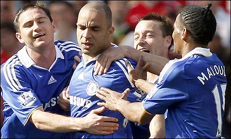 Alex (second left) gets mobbed by Chelsea team-mates after his opener for his side in the win at Arsenal