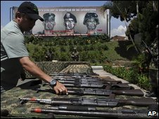 A soldier displays weapons and ammunition seized from the Farc rebel group, 6 May 2009