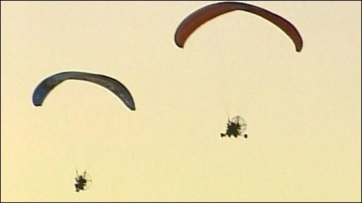 Two powered paragliders