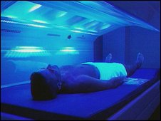 Man using sunbed