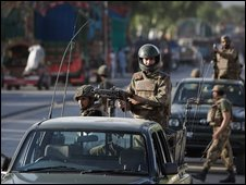 Pakistani paramilitary troops secure checkpoint on road to Swat
