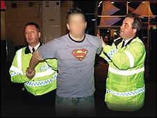 Drunk man being arrested