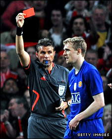 Italian referee Roberto Rosetti shows Darren Fletcher a red card