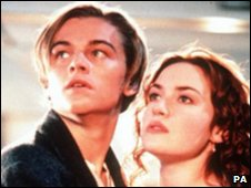 Leonardo DiCaprio, in character as Jack, holds Kate Winslet, as Rose, as the ship sinks in the epic drama Titanic