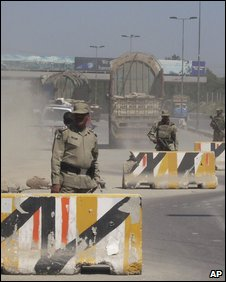 Soldiers of Pakistani paramilitary force stand guard at an entry post to northwest of Pakistan, in Attock, Pakistan