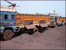 Lorries unloading iron ore