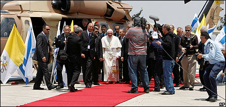 Pope Benedict surrounded by security and media after alighting from an Israeli army helicopter for a ceremony at the Mount Scopus