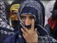 A woman evacuated from the Swat valley joins a rally calling for better humanitarian assistance from the government, 9 May, location unspecified