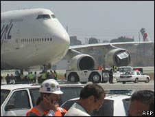 An object is seen wedged into the plane's engine (right) at LA airport
