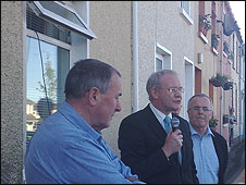 Mitchel McLaughlin, Martin McGuinness and Raymond McCartney at the rally in the Bogside