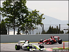 Jenson Button's Brawn leads Felipe Massa's Ferrari in Spain