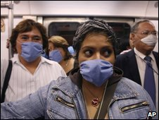 People in Mexico wear masks as a precaution