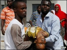 A young girl is rushed to Medina Hospital in Mogadishu, Somalia, on 10 May 2009