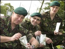 Troops tuck into ration packs