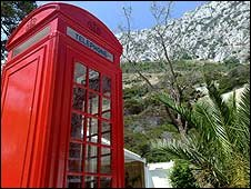 Red telephone box by rock of Gibraltar