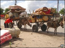 A man pack family belongings to flee Mogadishu on 12 May 2009