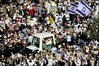 Pope Benedict XVI waves to Christian pilgrims as he arrives for the mass in Kidron Valley just outside east Jerusalem Tuesday, May 12, 2009.