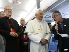 Vatican spokesman Father Federico Lombardi (right) reads out questions to Pope Benedict aboard plane en route to Jordan, 8 May