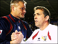 Burnley keeper Brian Jensen (left) and boss Owen Coyle