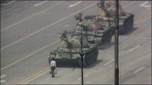 Protester in front of tank