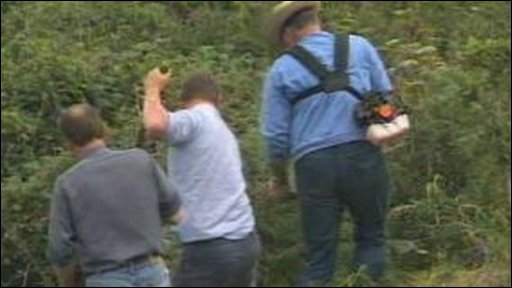 Archive, 1989: Men searching for evidence on a coastal path in Pembrokeshire