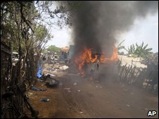 An ambulance burns outside a makeshift hospital in Mullivaikal, 13 May