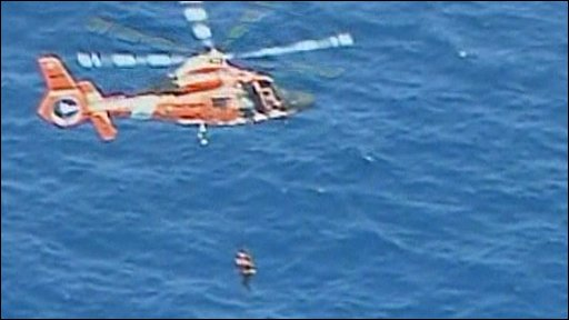 A person being rescued by helicopter