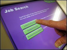 Person looking for a job at a Jobcentre Plus computer terminal